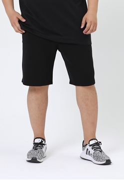 Plus size plain cotton sweat shorts in black color.